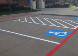 striped parking lot spaces