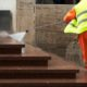 Worker Pressure Washing with emergency services